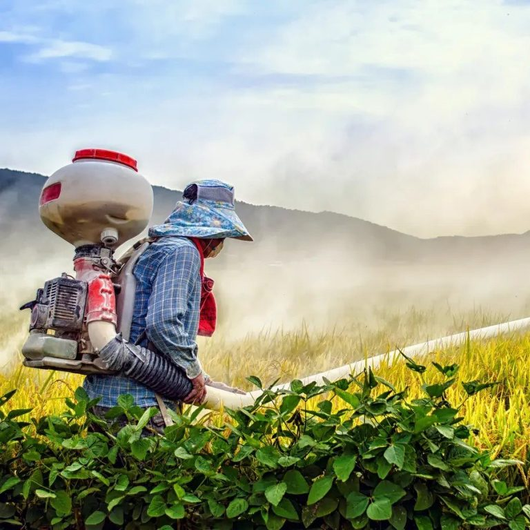 Worker Spraying Crops in Blog about Glyphosate in Honey