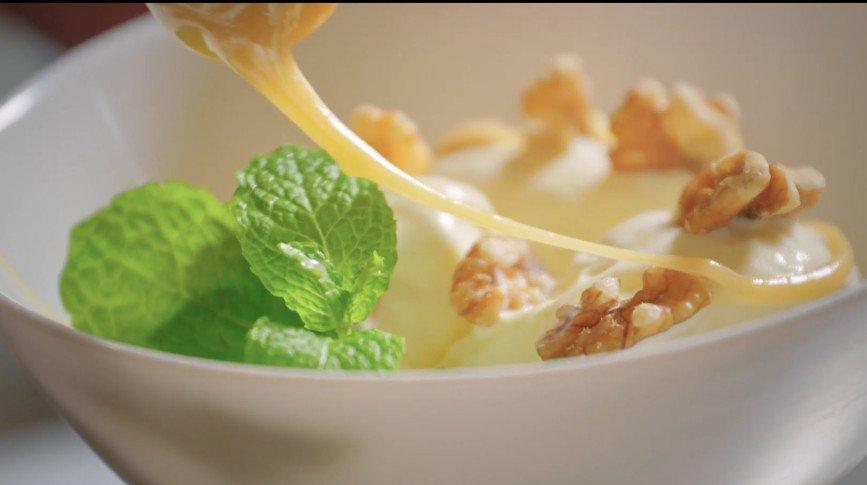 Rewarewa Honey by Manawa Honey NZ drizzled on ice-cream - thumbnail for video on properties of rewwarewa honey