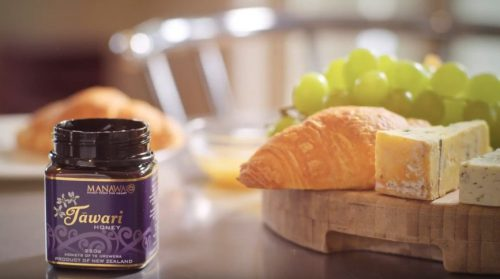 Tawari Honey by Manawa Honey NZ in open 250g jar with blue cheese, grapes and croissant