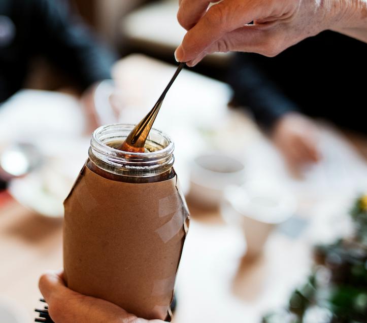 Dipping Honey for a Black Jar Honey Tasting Contest Like That Won By Manawa Honey NZ 2021