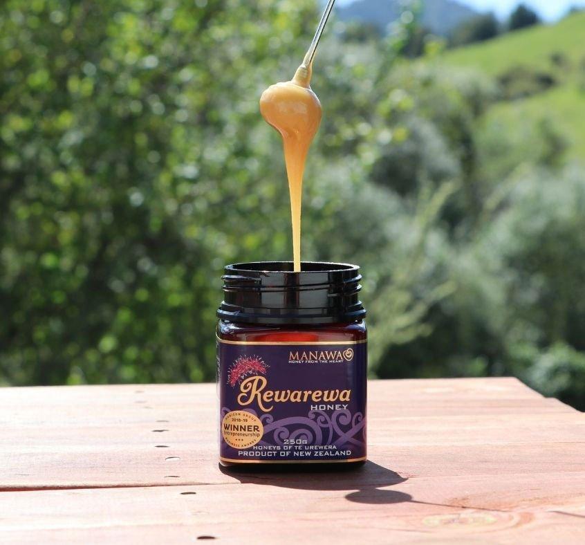 Rewarewa Honey By Manawa Honey NZ - The Best Tasting Honey In The World - Dripping Off Honey Dipper